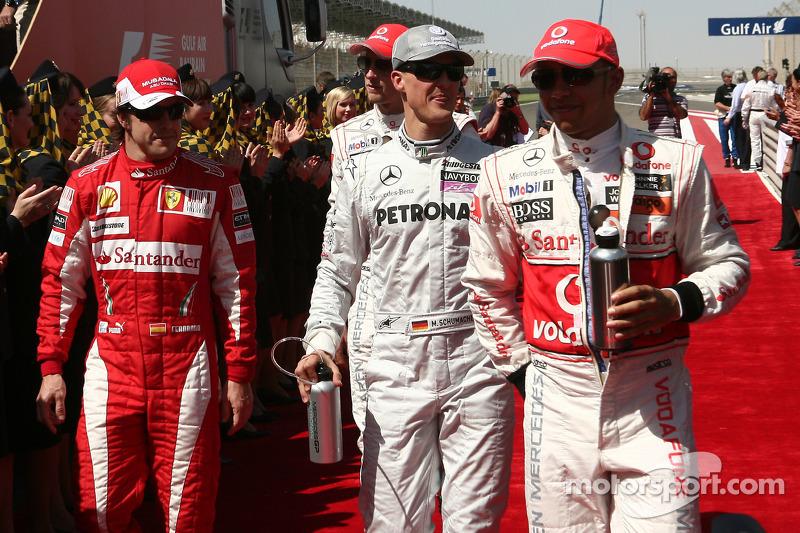 Fernando Alonso, Scuderia Ferrari con Michael Schumacher, Mercedes GP y Lewis Hamilton, McLaren Merc