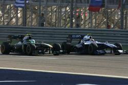 Heikki Kovalainen, Lotus F1 Team y Nico Hulkenberg, Williams F1 Team