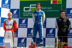 Giacomo Ricci celebrates his victory on the podium with Sam Bird and Alvaro Parente