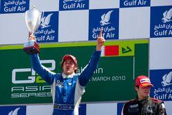 Giacomo Ricci celebrates his victory on the podium with Alvaro Parente