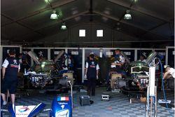 Team Peugeot Total at work in the paddock