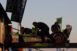 Patron Highcroft crew loads their Honda onto the transporter for the night