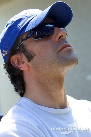 Dario Franchitti watches qualifying as his brother Marino is on his flying lap