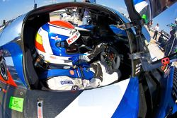 Marc Gene sits in his car after setting the fastest time