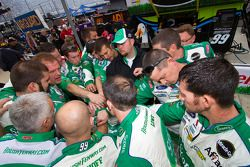 The Scott crew huddle on pit road before the race
