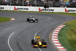 Robert Kubica, Renault F1 Team leads Nico Rosberg, Mercedes GP