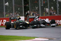 Heikki Kovalainen, Lotus F1 Team and Michael Schumacher, Mercedes GP