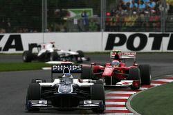 Rubens Barrichello, Williams F1 Team leads Fernando Alonso, Scuderia Ferrari