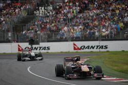 Jaime Alguersuari, Scuderia Toro Rosso leads Michael Schumacher, Mercedes GP