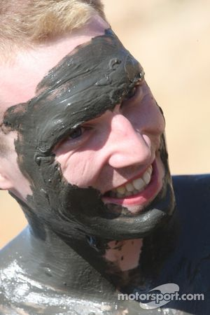 Jari-Matti Latvala gets ready for a dip in the Dead Sea by smearing himself in mud