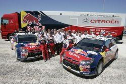 Sébastien Loeb and Daniel Elena, Daniel Sordo and Marc Marti, pose with Citroën Total World Rally Team team members