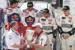 Podium: winners Sébastien Loeb and Daniel Elena, third place Petter Solberg and Philip Mills