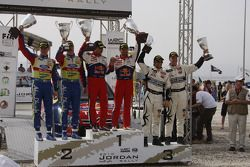 Podium: winners Sébastien Loeb and Daniel Elena, second place Jari-Matti Latvala and Miikka Anttila, third place Petter Solberg and Philip Mills