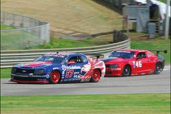 #57 Stevenson Motorsport Camaro GT.R: Andrew Davis, Robin Liddell passes #46 Autohaus Camaro GT.R::