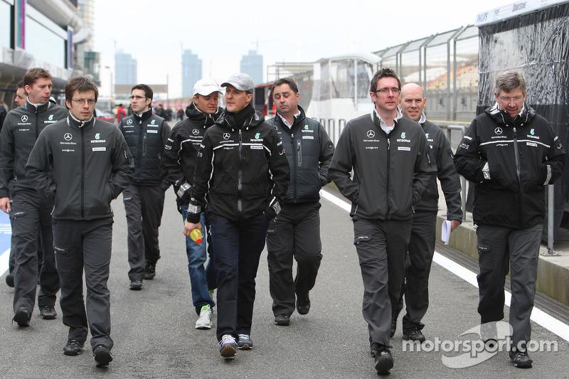 Michael Schumacher, Mercedes GP walk the circuit with Andrew Shovlin, Mercedes GP, Senior Race Engin