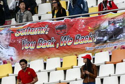 Fans with Banners for Michael Schumacher, Mercedes GP