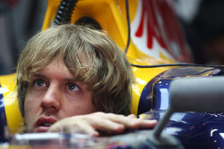 Sebastian Vettel, Red Bull Racing, adjusts his new wing mirror