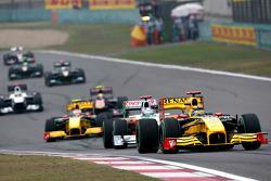 Robert Kubica, Renault F1 Team leads Adrian Sutil, Force India F1 Team