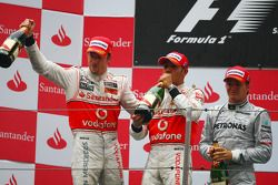 Podium: race winner Jenson Button, McLaren Mercedes, with second place Lewis Hamilton, McLaren Merce