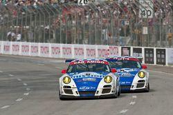 #80 Car Amigo-Alex Job Racing Porsche 911 GT3 Cup: Ricardo Gonzalez, Luis Diaz, #81 Alex Job Racing Porsche 911 GT3 Cup: Juan Gonzalez, Butch Leitzinger