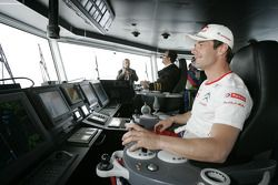 Sébastien Loeb guides the boat chartered by the organisers to take all the cars and drivers accross