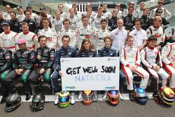 The 2010 FIA GT1 World Championship drivers group shot: the drivers have a message for Natacha Gachnang