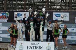 LMPC podium: class winners Gunnar Jeannette and Elton Julian, second place Scott Tucker and Christop