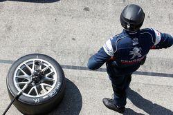 Team Peugeot Total team member at work