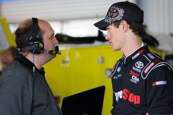 Joey Logano talks with crew chief Kevin Kidd