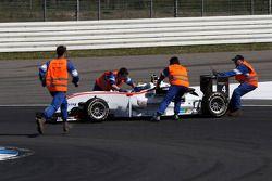 Track marshallers pushing the car of Carlos Munoz, Mücke Motorsport, Dallara F308 Mercedes