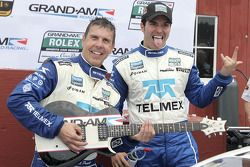 DP podium: class and overall winners Scott Pruett and Memo Rojas with their winning guitar