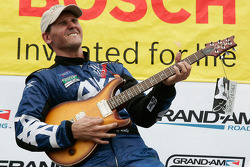 GT podium: class winner Andy Lally with the winning guitar
