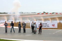 Fireworks and champagne christened the opening of the new Silverstone circuit: David Coulthard, Mark