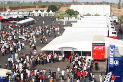 Fans wait for the Formula Two drivers autograph session