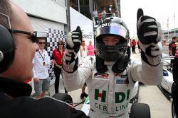 Kelvin Snoeks celebrates his race 1 third place in parc ferme