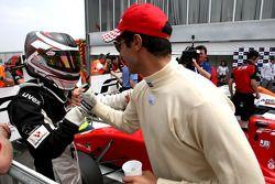 Philipp Eng, left, celebrates his race 1 second place in parc ferme