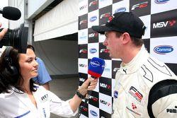 Race 1 winner Dean Stoneman is interviewed in parc ferme