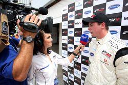 Race 1 winner Dean Stoneman is interviewed