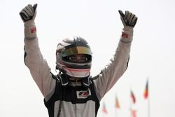 Philipp Eng celebrates his win in parc ferme