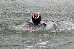 Race winner Jorge Lorenzo, Fiat Yamaha Team celebrates by jumping in the lake