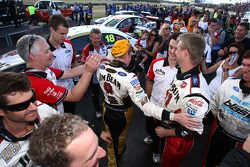 James Courtney celebrates with his team after taking out back to back races at the Ipswich 300