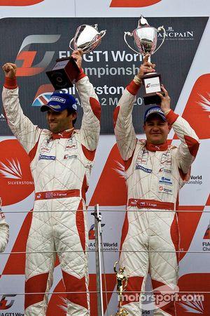Podium: provisional race winners Darren Turner and Tomas Enge