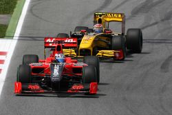 Timo Glock, Virgin Racing VR-01 leads Vitaly Petrov, Renault F1 Team