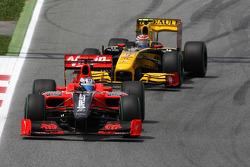 Timo Glock, Virgin Racing VR-01 leads Vitaly Petrov, Renault F1 Team