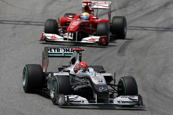 Michael Schumacher, Mercedes GP Petronas leads Felipe Massa, Scuderia Ferrari