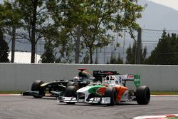 Адриан Сутиль, Force India F1 Team, и Ярно Трулли, Lotus F1 Team