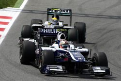 Nico Hulkenberg, Williams F1 Team, leads Nico Rosberg, Mercedes GP Petronas