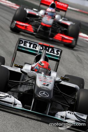 Michael Schumacher, Mercedes GP Petronas leads Jenson Button, McLaren Mercedes