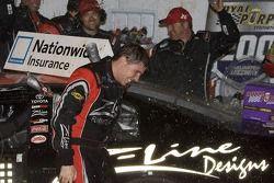 Victory lane: Denny Hamlin celebrates