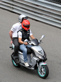 Michael Schumacher, Mercedes GP rides around the circuit with Andrew Shovlin, Mercedes GP, Senior Race Engineer to Michael Schumacher